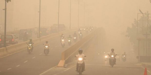 Gara-gara Kabut Asap, Pengguna Jalan di Pekanbaru Jadi Lebih Tertib Berlalu Lintas
